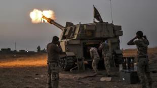 Les forces irakiennes près du village d'Al-Muftuya, à 35 kilomètres de Mossoul, le 19 octobre 2016.