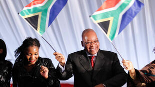 Jacob Zuma brandishes the South African flag