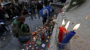 Blue, white and red candles in the colours of the French flag burn at the Place de la Republique in Paris on November 13, 2016, after ceremonies held for the victims of last year's Paris attacks.