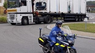 Police escort the lorry carrying the remains of victims of the  AF447 crash