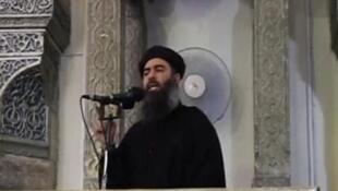 O líder do grupo Estado Islâmico, Abu Bakr al-Baghdadi, durante declaração pública em Mossul, em 2014.