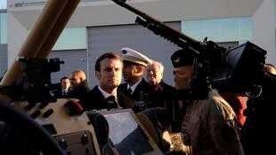 French President Emmanuel Macron talks to soldiers as he visits the 123 Air Base of Orleans-Bricy to give his New Year speech to France's armed forces, in Boulay-les-Barres near Orleans, France January 16, 2020.