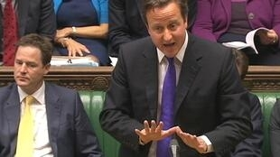 Britain's Prime Minister David Cameron speaks about phone hacking to parliament in a still image taken from video in London 20 July 2011.