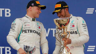Lewis Hamilton (right) won the Russian Grand Prix after the Mercedes team managers told his teammate Valtteri Bottas (left) to let him overtake.