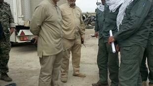Qassem Soleimani (L) with fighters in 2015