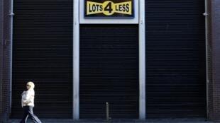 A pedestrian walks past a discount store in central Dublin, 14 November