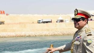 Egyptian President Abdel Fattah al-Sisi stands in boat on the Suez Canal.