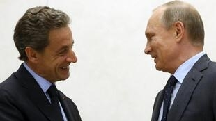 Russian President Vladimir Putin (R) meets with Nicolas Sarkozy, French former president and head of the conservative Les Republicains political party, outside Moscow, Russia, October 29, 2015