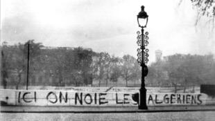 """Algerians are drowned here"" grafitti on Quai de Tournelle wall near Saint Michel, Paris"