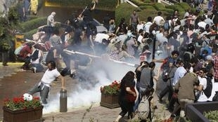Turkish riot police use tear gas to disperse demonstrators at Gezi Park in Istanbul, 31 May, 2013