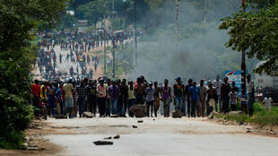 Protesters barricade the main street to Zimbabwe's capital Harare from Epworth Township, January 14, 2019