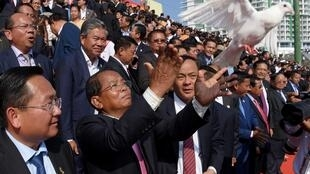A dove is released at Phnom Penh's Olympic Stadium during official celebrations marking the 40th anniversary of the fall of the Khmer Rouge.