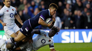 Scotland's Huw Jones scores his second try against England in the Six Nations tournament.