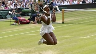 Serena Williams celebrates after winning her match against Victoria Azarenka at the Wimbledon Tennis Championships in London, 7 July 2015.