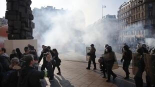 French police use tear gas to disperse protestors at an earlier Yellow Vest demonstration in Paris.