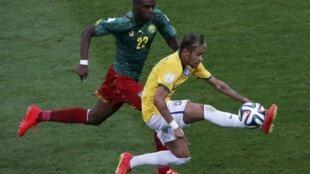 Cameroon's Allan Nyom, Brazil's Neymar, Brasilia national stadium