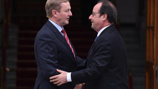 French President Francois Hollande (R) is greeted by Irish Prime Minister Enda Kenny in Dublin