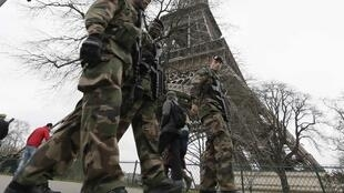 Troops posted at the Eiffel Tower in Paris