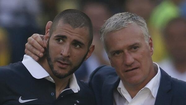 France's coach Didier Deschamps (R) consoles Karim Benzema after the team's loss against Germany.