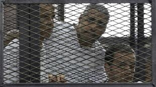 Three journalists working for Al Jazeera- Peter Greste, Mohamed Fahmy and Baher Mohamed (L-R) have been jailed in Egypt