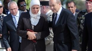 Défense Minister Jean-Yves Le Drian with Latifa Ibn Ziaten, Toulouse, 11 March 2013