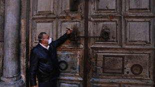 Adeeb Joudeh, the custodian in charge of the ancient key to the Church of the Holy Sepulchre, closed the entrance to the site on March 25, 2020 as part of efforts to stem the spread of the novel coronavirus