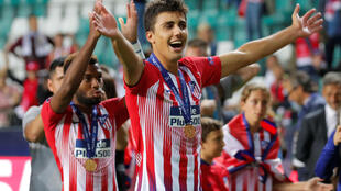 Atletico Madrid's Rodri celebrates after winning the Super Cup