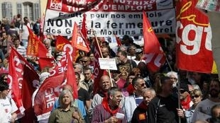 Demonstrators take part in the French unions' traditional May Day march