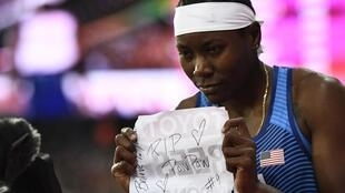 Brittney Reese paid tribute to her grandfather who died just before the world championships in London.