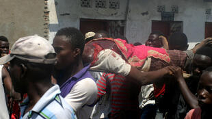Dead protester carried on stretcher through Buterere Bujumbura during protests, 12 May 2015