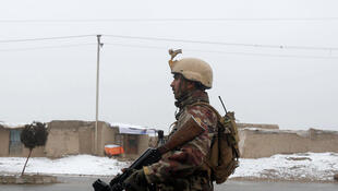 An Afghan security force member stands guard near the site of an attack at the Marshal Fahim military academy in Kabul, Afghanistan January 29, 2018.