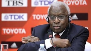 File photo of then-outgoing President of IAAF Diack attending a news conference in Beijing