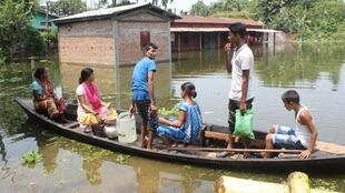 A family displaced by the floods in Assam state, north-eastern India.