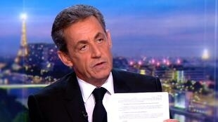 This video grab taken from footage released by French television channel TF1 shows French former president Nicolas Sarkozy speaking during an interview on March 22, 2018 at the TF1 headquarters in Boulogne-Billancourt