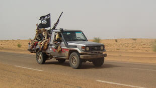 Members of Movement for Unity and Jihad in West Africa approach Timbuktu