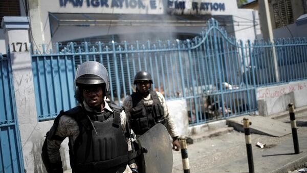 Haitian National Police (PNH) officers in front of immigration building during an anti-government protest in Port-au-Prince, 28 October 2019