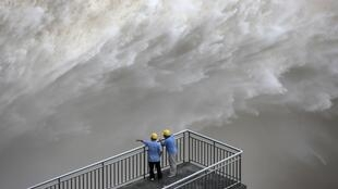The Three Gorges Dam discharges water to lower the level in a reservoir in Yichang, Hubei province