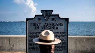 Superintendent of Fort Monroe National Monument, Terry E. Brown, poses near a historical marker at the fort, on 19 August 2019, in Jamestown, Virginia.
