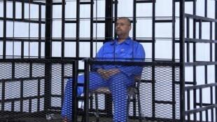 """عکس آرشیو - سیف الاسلام قذافی"""" پسر معمر قذافی، در دادگاه شهر الزنتان. ٢۵ مه  ٢٠١٤"""