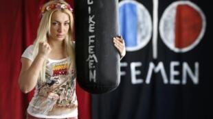 Ukrainian activist Inna Shevchenko, leader of the women's rights group Femen poses at their 'training camp' at the Lavoir Moderne Parisen in Paris