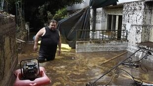 A man tries to pump the water out of his apartment in Lamalou-les-Bains