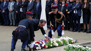 French President Francois Hollande lays a wreath of flowers during a ceremony for victims of terror attacks in Paris, France, September 19, 2016.