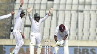 Bangladeshi players successfully appeal for a leg before wicket decision against Sunil Ambris during the second Test.