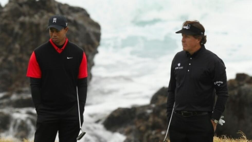 Tiger Woods, left, and Phil Mickelson are reported to be ready to tee off for charity by holding a golf match that would also include US football legends Tom Brady and Peyton Manning