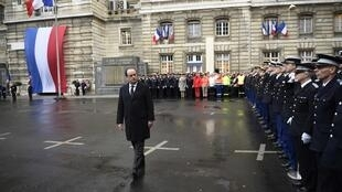 French President François Hollande with French anti-terror Sentinelle security forces at Paris police headquarters