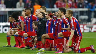Bayern Munich players celebrate after beating Porto in their Champions League semifinal match on Tuesday