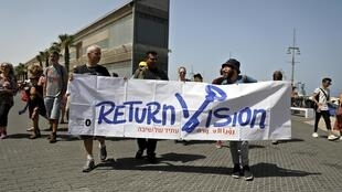Những người chống chung kết Eurovision tại Tel Aviv, Israel giương biểu ngữ phản đối, ngày 18/05/2019.