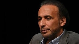 """In this file photo taken on March 26, 2016 Swiss Islamologist Tariq Ramadan takes part in a conference on the theme """"Live together"""" in Bordeaux."""