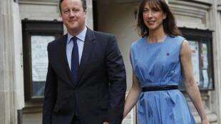 Британский премьер-министр со своей женой Самантой уже приняли участие в референдуме о выходе Великобритании из ЕС, Лондон, 23 июня 2016.