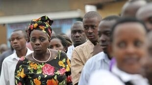 Ugandan voters queue to cast their votes in presidential and parliamentary election in Uganda